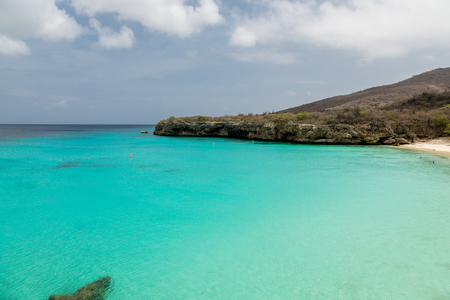 stone volcanic stones: Clear aqua water off the rocky coast of Curacao