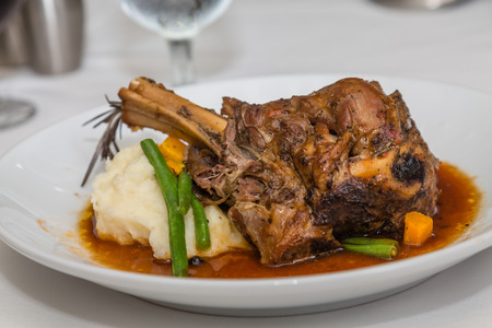 Fresh lamb shnk on a bed of mashed potatoes