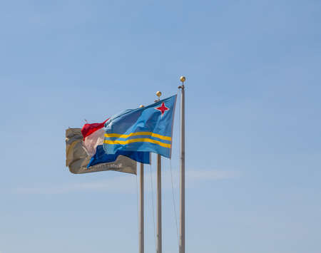 The Flags of Aruba and Netherlands in blue sky Stok Fotoğraf