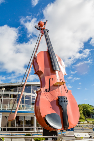 cellos: Giant violin in the harbor of Syndey, Nova Scotia