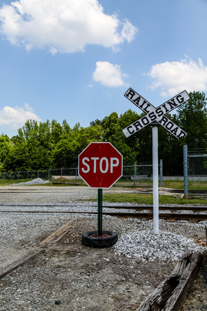 railroad crossing: A stop sign at a railroad crossing Stock Photo
