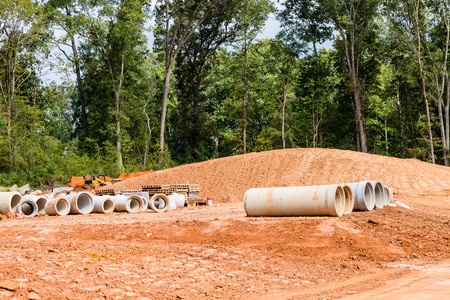 Cement Sewer Pipes at a residential Construction Site Stock Photo