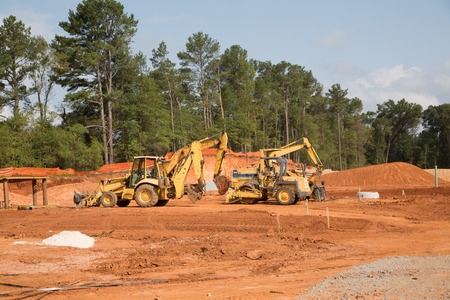 heavy industry: Heavy construction equipment in a new residentail site Stock Photo