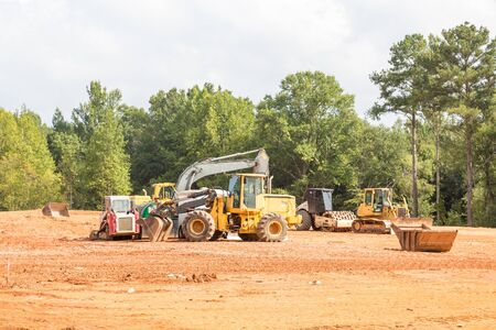 grading: Heavy construction equipment in a new residentail site Stock Photo