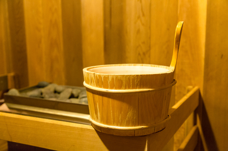 traditional wellness: Wood water bucket in nice cedar sauna Stock Photo