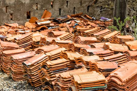 Stacks of old roof tiles in a yard Stock Photo
