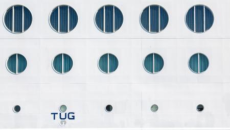 bulkhead: Portholes in Ships Bulkhead with Tug point at bottom