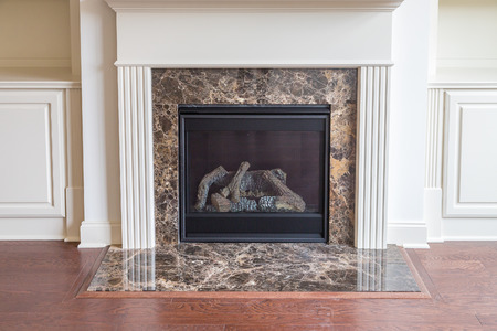 polished: A Gas Fireplace with New Hardwood Floor in new home