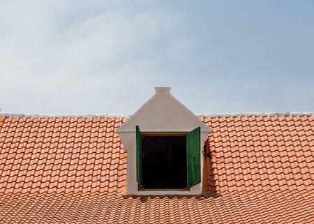 dormer: White Dormer in Red Tile Roof