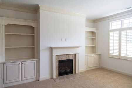 fireplace home: A new home with fireplace and builtin bookcases Stock Photo