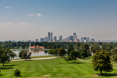 denver skyline: View of the Denver skyline across green park