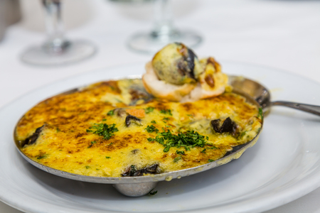 buttery: A dish of hot, buttery escargot on a dinner table Stock Photo