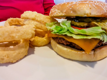 Lunch of Onion Rings with Deluxe Cheeseburge