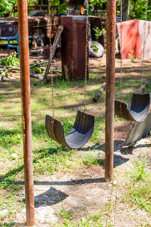 junkyard: Swing Made from Tire in junkyard Stock Photo