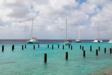 bonaire: White yachts and sailboats moored off the coast of Bonaire
