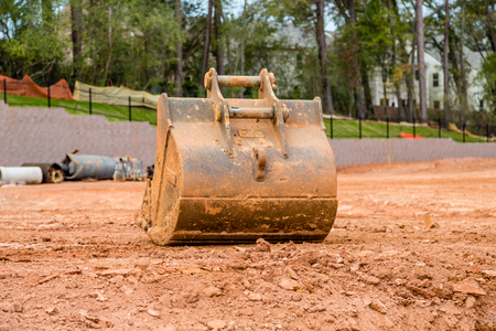 earth moving equipment: Earth moving equipment on a residential construction site