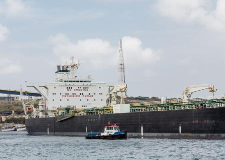 tanker ship: A massive tanker ship leaving the harbor on Curacao