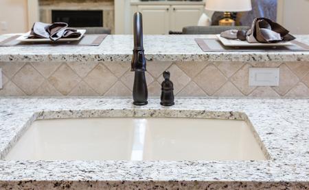 countertops: Beautiful new granite countertops in a kitchen Stock Photo