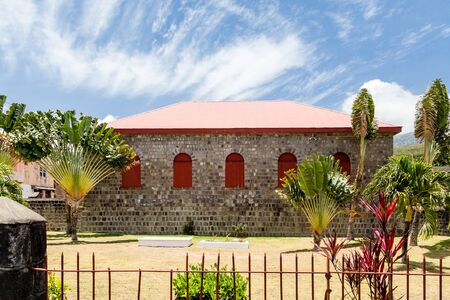 red shutters: Red Shutters on Stone Building on St Kitts