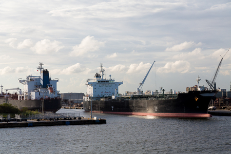 Massive tankers in an urban industrial port