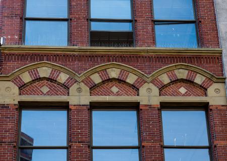 portland: Ornate Brickwork Around Blue Windows in Portland
