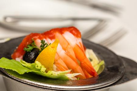 Four Shrimp Cocktail with Lemon Wedge in silver bowl Banco de Imagens