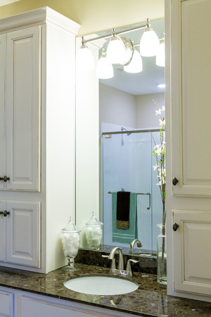 Sink in Modern Granite Countertop with lights and mirror