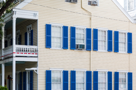 two story: Blue Shutters on Yellow Siding two story Home