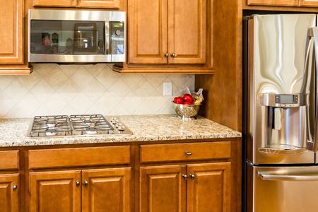 kitchen countertops: Beautiful new granite countertops in a kitchen Stock Photo
