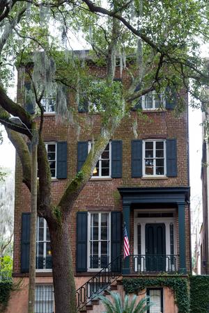 southern: Brick American Townhouse by Oak Tree in Savannah