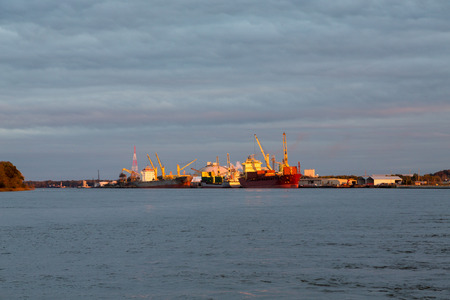 freighter: A Freighter and Tanker at Dusk docked