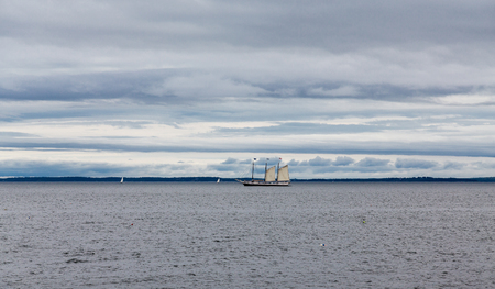 Three masted sailboat flying only two sails Stock Photo