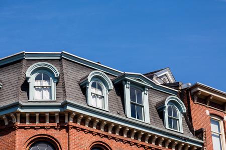 mansard: Mansard roof on an old brick building in Portland, Maine