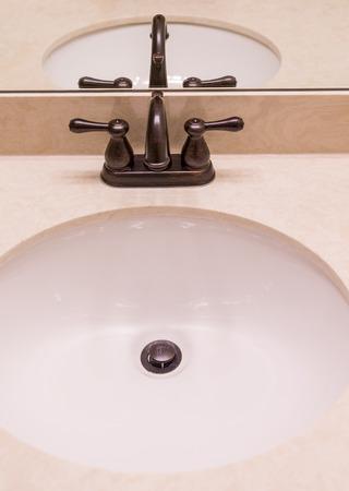 fixtures: Oil rubbed Bronze Fixtures on Marble Sink Stock Photo