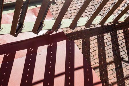 metallic stairs: Shadows of Steps on Brick Wall