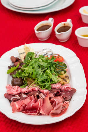 Thinly Sliced Meats with Arugula Salad with gravy
