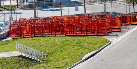 barrier: Metal Orange Barricades ready for traffic