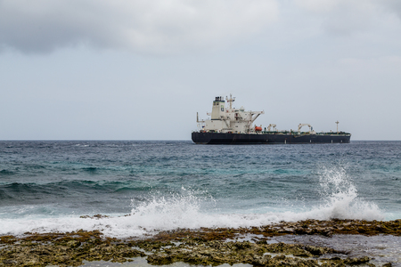 beyond: Tanker Beyond Crashing Surf on Curacao