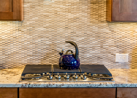 gas stove: Well decorated and modern kitchen with granite countertops