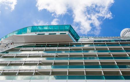 suny: Blue Glass Balconies on Cruise Ship Under Suny Sky