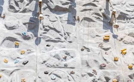 A rock climbing wall on a cruise ship with bells at top Stock Photo