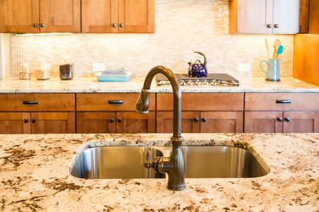 kitchen countertops: Well decorated and modern kitchen with granite countertops
