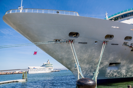 ship bow: Bow of Cruise Ship Tied to Black Bollard with blue rope Stock Photo