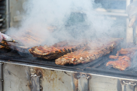 sizzling: Sizzling Meat Being Cooked on a Barbecue Grill