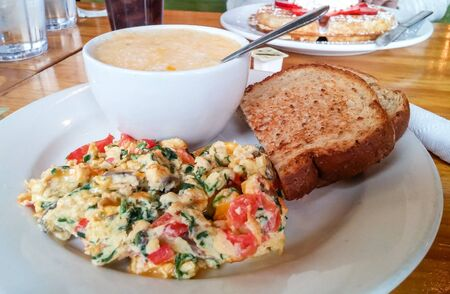 scramble: Vegetable Scramble with Grits and Toast on table