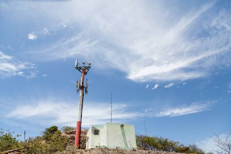 Cell Phone Tower on a tropical hill on St Kitts Stock Photo