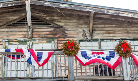 christmas wreaths: Bunting and Christmas Wreaths on Old Wood Building in Key West
