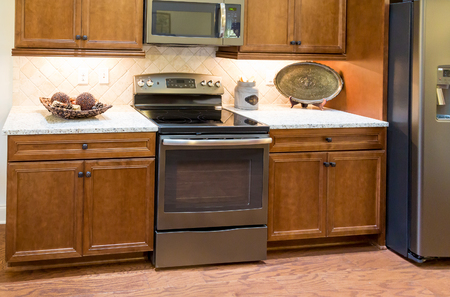 kitchen cabinets: Stainless Steel Range in New Kitchen with wood cabinets