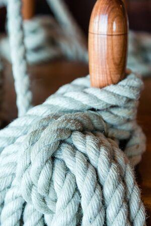 belaying: Blue Rope on Belaying Pin on Sailing Ship