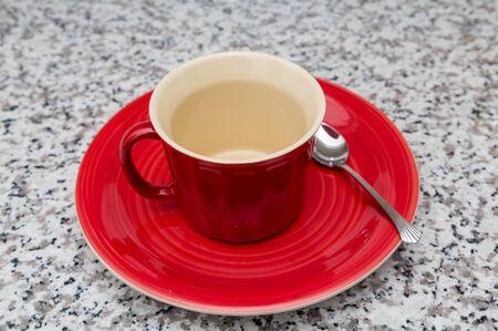 granite countertop: Red Mug and Plate on granite countertop Stock Photo